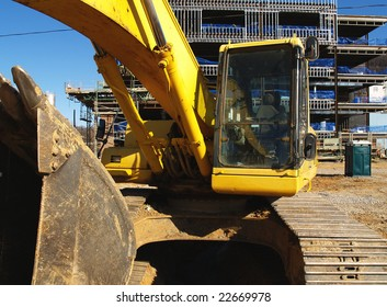 This excavator is parked and building progress is parked until the economy rebounds.