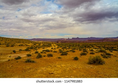 This is an expansive view of the desert landscape seen on the way to the Millard Canyon area of the Maze District of Canyonlands NP in Utah. Beautiful land formations are seen  in the distance.