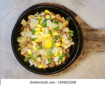 This is famous in the Philippines. It's called sisig. It' mainly composed of tiny pork bits,mixed with onions, egg, calamansi, and some veggies.
