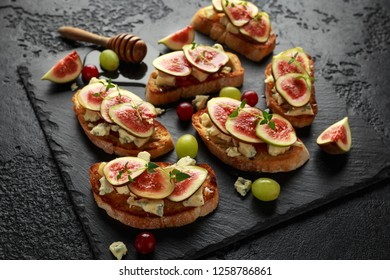 This Fig and Gorgonzola tartines, toast, bruschetta. drizzled with honey.