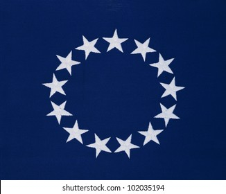 This is a flag with 13 stars sewn in a circle in a field of blue. This was the Original Colonial Flag from the Revolutionary War.