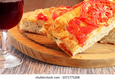 This flat Italian bread is quick and easy to bake and only requires one rising.  Pair it with soup or salad and you have a complete meal