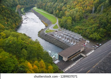 This is the Fontana Dam, at 480 ft. near Bryson City, NC, at the southern border of Smoky Mts. NP. When it was built in the 1940's, it was the highest dam in the Eastern US. Autumn colors frame image.