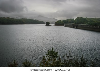This is Fontana Lake, located in Nantahala NF near Bryson City, North Carolina, on a very stormy day. The clouds are engulfing the distant  mountains, and the lake is reflecting the color of the sky.
