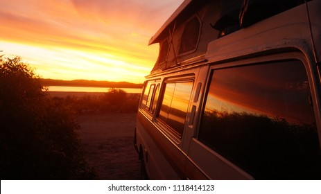 this footage was taken in South Australia. It shows  in the foreground a campervan and in the background a beautiful sunset.