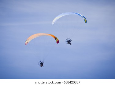 This form of ultralight aviation is called powered paragliding or paramotoring. The aircraft can be used to herd reindeer, transport soldiers or hire to adrenaline junkies.