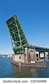This is the Fremont drawbridge in Seattle, WA, lifted up from Lake Union perspective.  It's a steel double-leaf bascule bridge that is a major transportation object in the region.