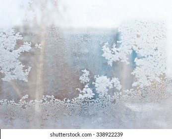 This is frosty pattern on glass winter window, look through glass