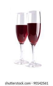 This are  glasses with red wine isolated over white