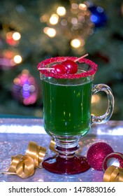 this green grinch drink with a red sugar rim and a cherry garnish, is the perfect holiday treat. made alcoholic or virgin for the kids ( no alcohol) this drink will be a big hit