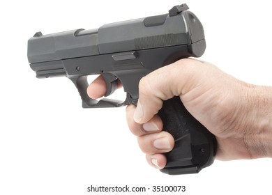 This is a hand holding a gun shooting