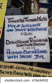 This is an handmade food signboard, met in a small tuscany village, where a shop was selling typicals product of food and wine.