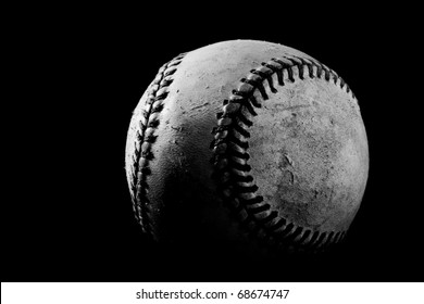 This is a high contrast, black and white shot of an old baseball. Shot on a black background with a hard light source.