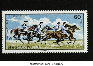 This is the Hortobagy series hungarian postage stamps showing the hungarian horsesmen doing the every day jobs.Here they are racing out on the plains.