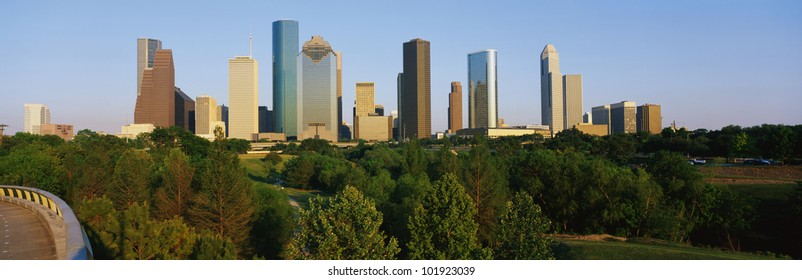 This is the Houston skyline with Memorial Park in the foreground. It is in afternoon light.