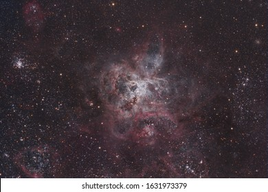 This is a huge nebula commonly referred to as The Tarantula. It is the largest and brightest emission nebula in the Large Magellanic Cloud and one of the largest known. Considering it's distance to Ea
