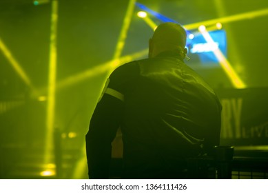 this image is a back shot of a bouncer looking after people inside a night club night club, security, bouncer