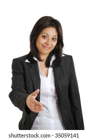 This is an image of a business woman offering handshake.
