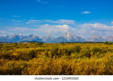 This image was captured at a viewpoint along the Teton Park Road. The Teton peaks are seen in the distance with  sagebrush grasses in the foreground, at Grand Teton National Park in Wyoming.