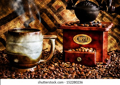 This image is a closeup of a cup of steaming hot coffee with coffee beans, coffee grinder, and coffee beans bag in background.