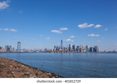 This image contains views of Jersey City and Manhattan, from Liberty State Park. You can see Goldman Sachs Tower, 432 Park, Empire State Building, Freedom Tower, Ellis Island, and the Brooklyn Bridge.