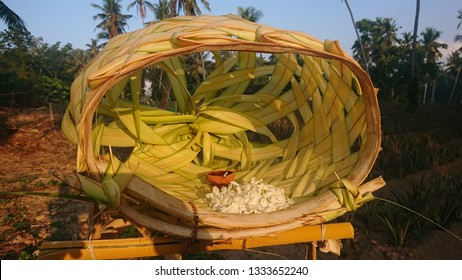 this image displays a traditional arrangement made of coconut leaves used in religious offerings during building construction.