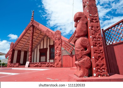This image shows a maori marae (meeting house and meeting ground)