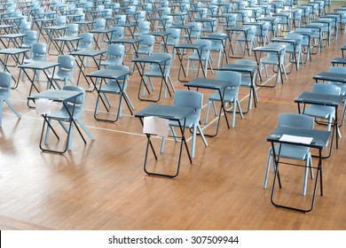 This image shows rows of empty desk waiting for student testing.