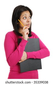 This is an image of student holding a pencil and folder whilst thinking