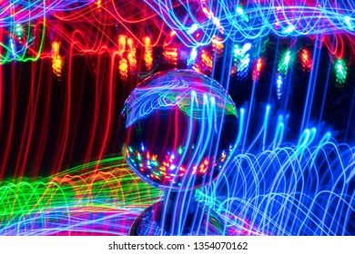 This image was taken using long exposure photography along with a crystal ball showing the reflections of colorful LED lights.