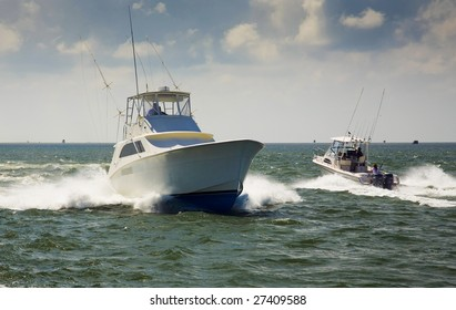 This is an image of two passing fishing boats.