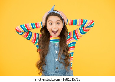 This is incredible. summer holiday and vacation. colorful spring fashion. vintage styled headscarf. happy childrens day. small girl feel surprised. cheerful and carefree. trendy kid yellow backdrop.