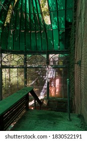 This is an interior view of the conservatory/greenhouse with an opaque green glass covering at the long-abandoned and historic Dunnington Mansion in Farmville, Virginia.