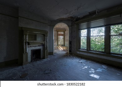 This is an interior view of the corner room with a fireplace and turret at the long-abandoned and historic Dunnington Mansion in Farmville, Virginia.