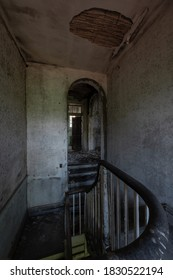 This is an interior view of a foyer atop a staircase at the long-abandoned and historic Dunnington Mansion in Farmville, Virginia.