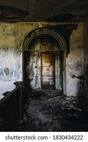 This is an interior view of the second floor foyer with a unique arch opening at the long-abandoned and historic Dunnington Mansion in Farmville, Virginia.