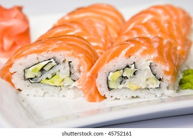 This is japanese rolls, placed on the white plate.