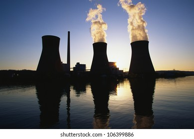 This is the John Ames Power Plant. It is a coal utility company located on the Kanoa River at sunset .