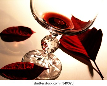 This is just a little macro I did involving red wine and poinsetta leaves.  Not much, pretty simple.