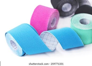 """This kind of taping is called """"Kinesiotape"""". Its purpose is to detonisize the muscle to reduce pain. In some cases you can also tonisize the muscle."""