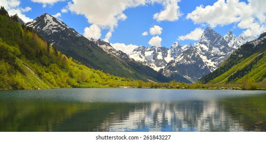 This is lake in Caucasus mountains in spring