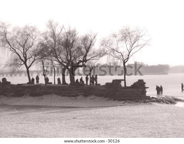 This is a lakeshore in China at the Summer Palace.