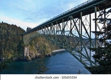 This large steel bridge is over treacherous channel water in this landscape image of Deception Pass, located in Island County, Washington State, America.