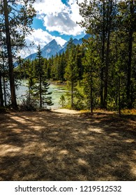 This is Leigh Lake in  Grand Teton National Park in Wyoming, captured through an opening in the woods on the trail. The Teton peaks are seen in the background.
