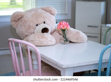 This life sized teddy bear takes time to smell the flowers.. even if they are fake