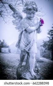 This little angel stands in a cemetery, watching and waiting.
