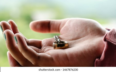 """This is the """"Lord of the Rings"""" ring of power in hands of a woman."""