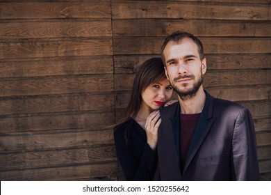 This is love. girl with guy posing on a wooden background. happy valentines day. summer vibes. couple relax outdoor. Couple relaxing enjoying each other. Hipster and pretty woman in love. Fall in love