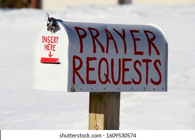 This mail box has the words prayer requests written on it.  There is a place in the front of the mail box for a person to insert their prayer.  It was photographed during the winter.