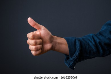 this male thumb up sign shows with this international gesture everything is okay and eveythigs fine